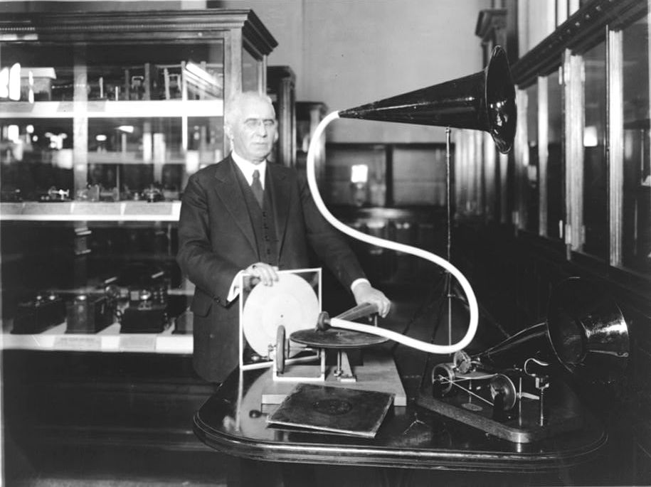 Emile Berliner, with the model of the first phonograph machine which he invented.