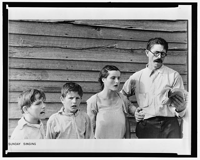 Frank Tengle, an Alabama sharecropper, and family singing hymns