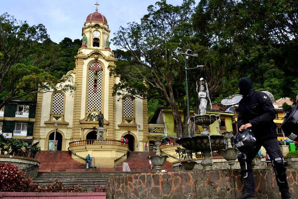 A beautiful square in the town of Fredonia in Antioquia with the Santa Ana church and its nice fountain.