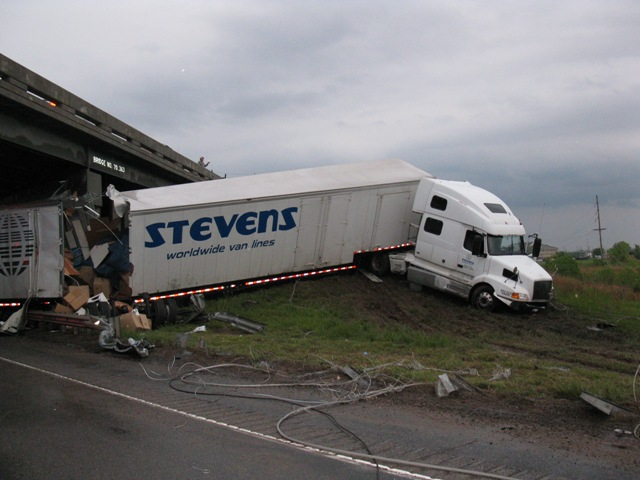 A truck wreck at an overpass
