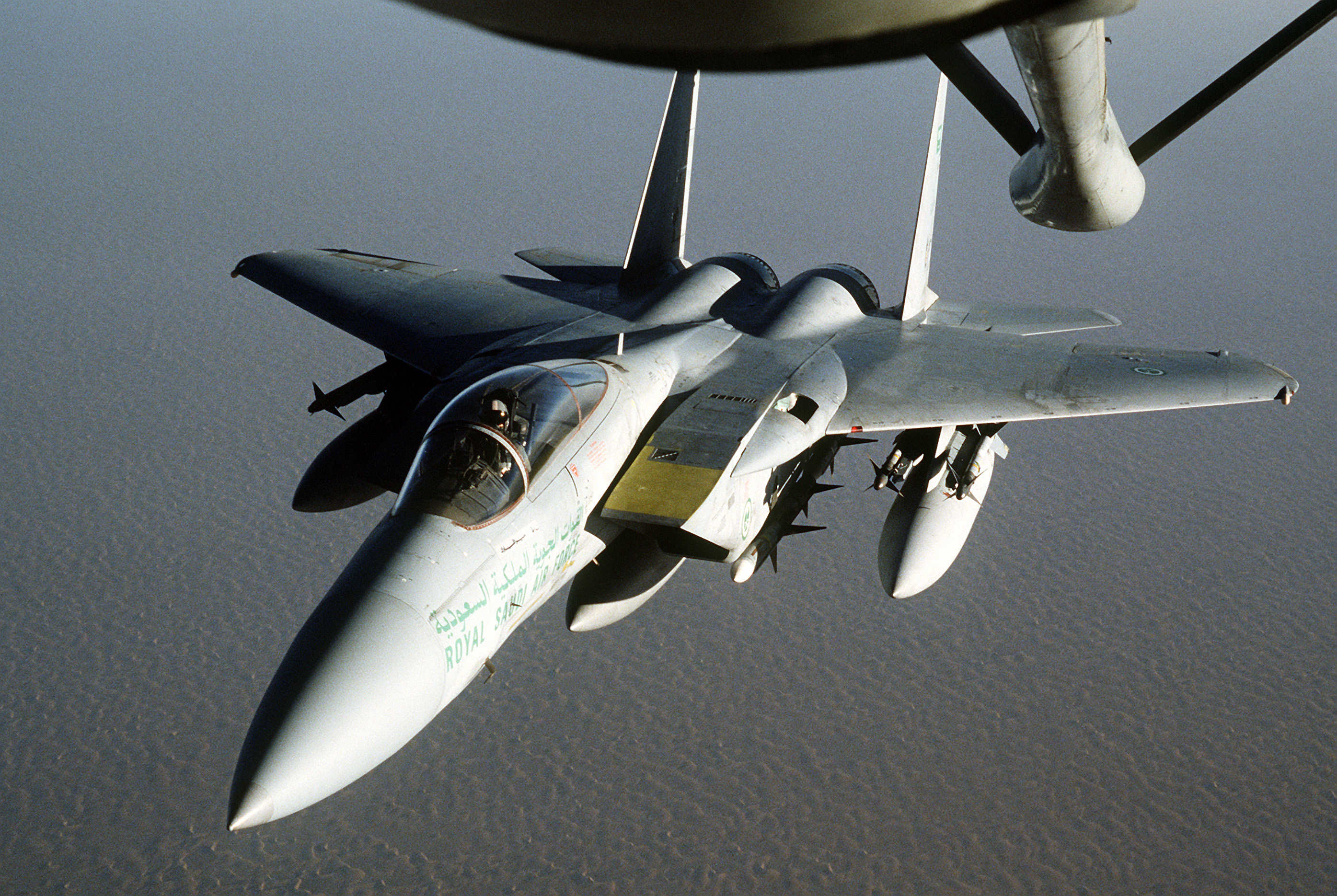 An RSAF F-15 approaches a KC-135 for refueling during Operation Desert  Shield.