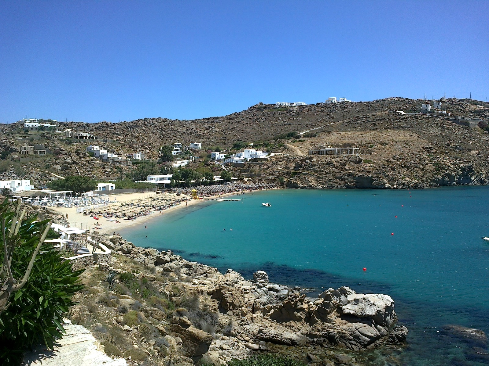 Super Paradise beach in Mykonos. A long, white sand beach.