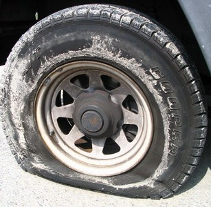 Spare tire additional tire carried in a motor vehicle as a replacement for one that goes flat, a blowout, or other emergency