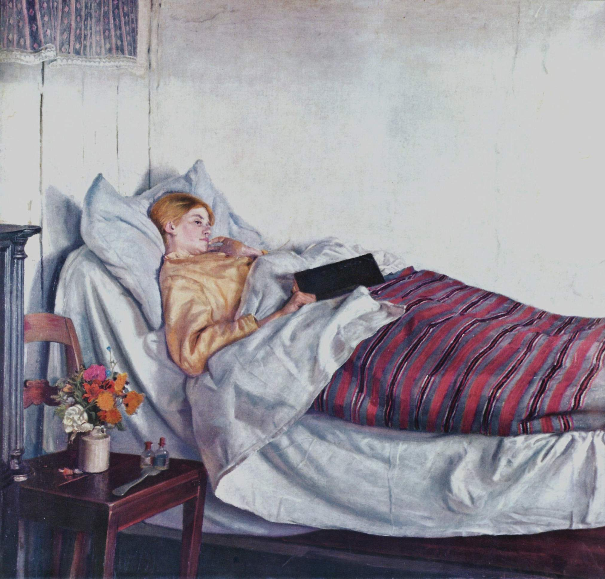 Woman sick in bed reading