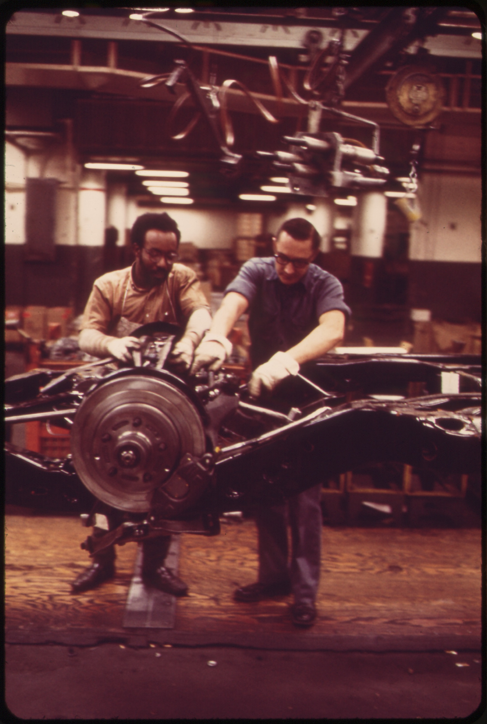ON_THE_CADILLAC_ASSEMBLY_LINE-ATTACHING_
