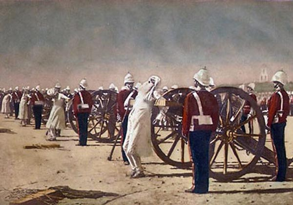 Suppression of the Indian Revolt by the English, which depicts the execution of mutineers by blowing from a gun by the British, a painting by Vasily Vereshchagin c. 1884. Note: This painting was allegedly bought by the British crown and possibly destroyed (current whereabouts unknown). It anachronistically depicts the events of 1857 with soldiers wearing (then current) uniforms of the late 19th century. Vereshchagin-Blowing from Guns in British India.jpg