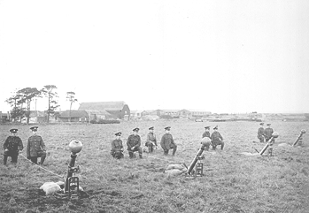 THE ROYAL ENGINEERS EXPERIMENTAL STATION AT PORTON DOWN DURING THE FIRST WORLD WAR Description: Mortar section with 2 inch Toffee Apple mortar bombs during trials at Porton