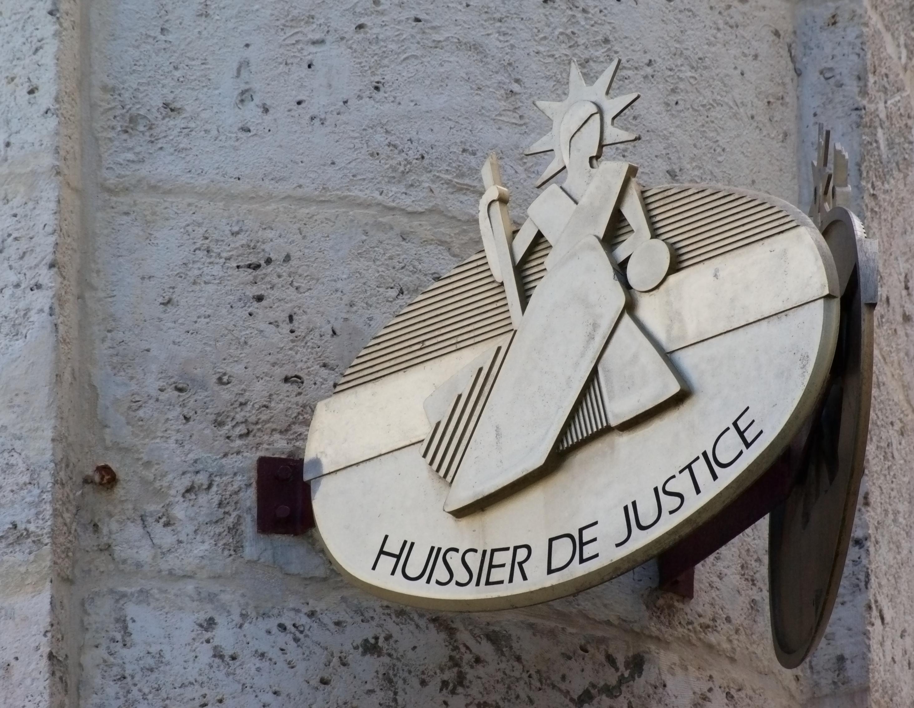 huissier de justice sign
