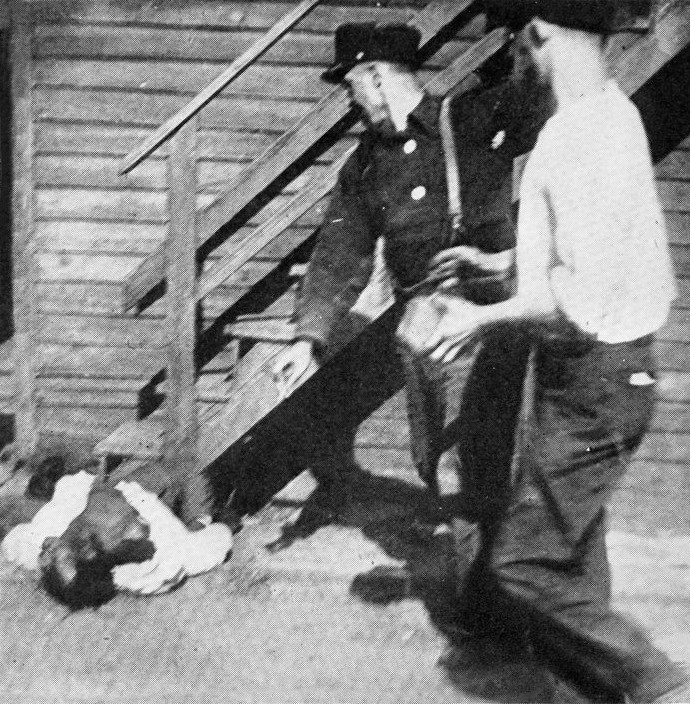 an African American man assaulted with stones during the Chicago Race Riot, public domain image