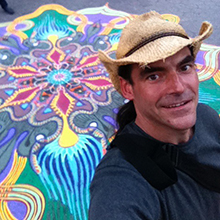 Joe Mangrum in front of sand painting at Union Square.jpg