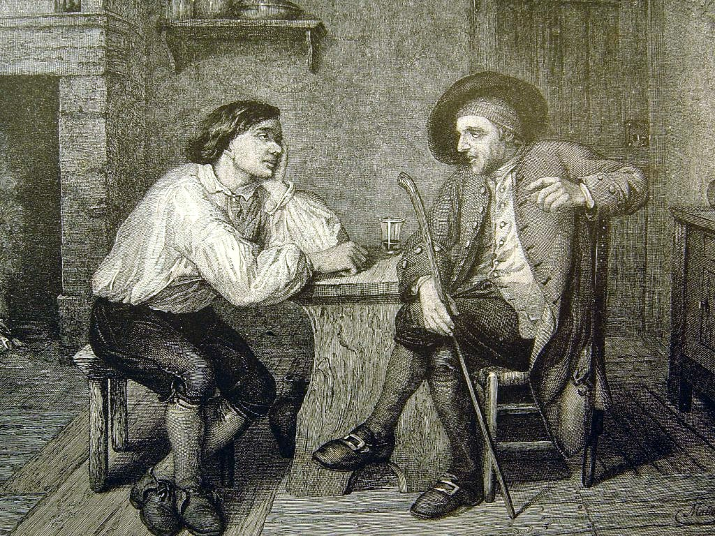 Black and white etching of two men sitting at a table. The older man is talking and the younger listening.