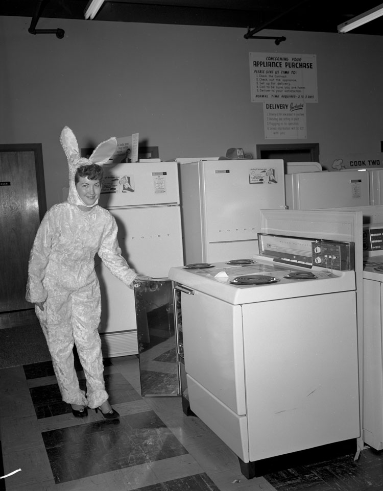 File:Lowes of Richmond, woman in bunny suit showing a stove