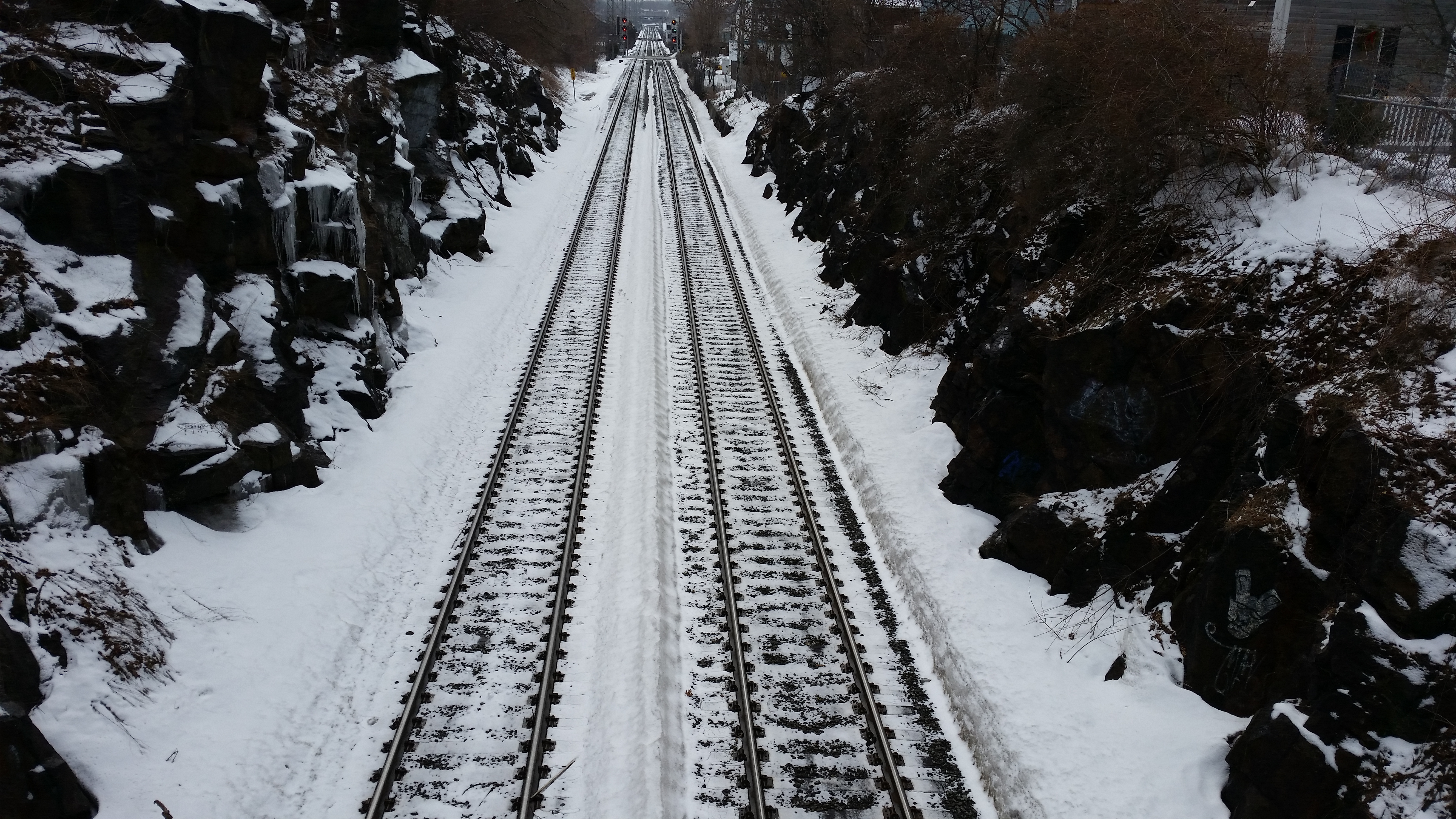 Going Home. By L Eaton (Snowy Train Tracks - 20150321_130326 [CC BY-SA 2.0 http://creativecommons.org/licenses/by-sa/2.0], via Wikimedia Commons).