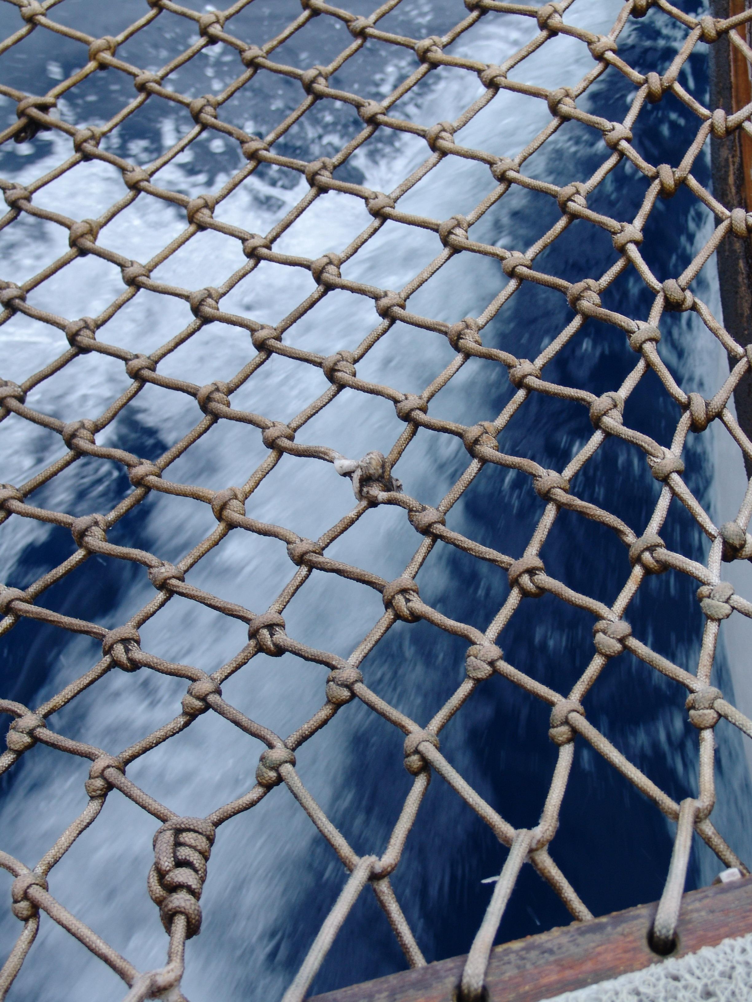 filea boats wake seen through a rope netjpg