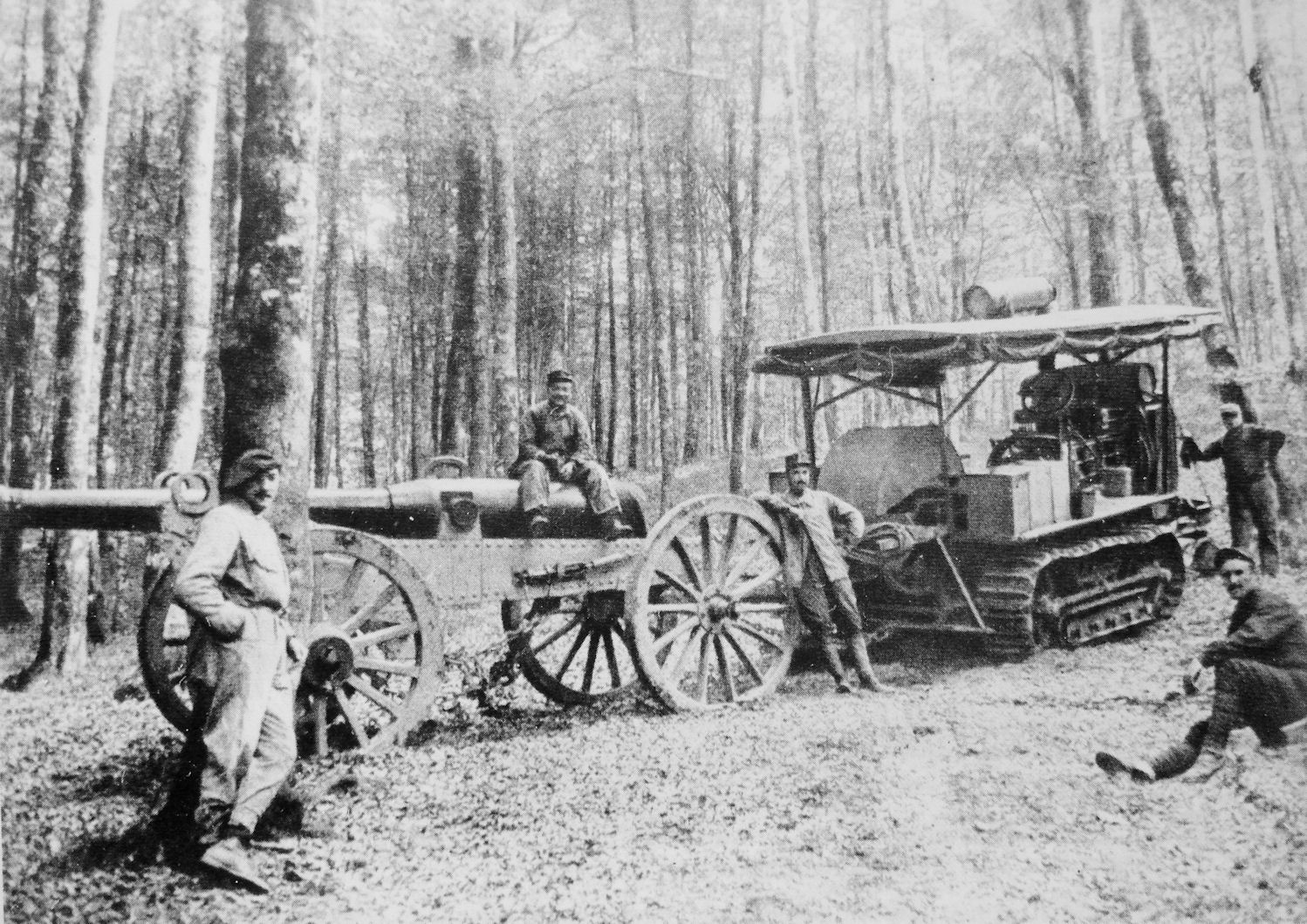 A casual group of French soldiers in 1915, with their American-built Holt tractor, hauling a cannon through the Vosges mountains.