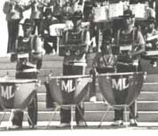 This 1976 photograph shows marching timpani grounded with legs extended.