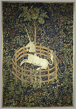 A white unicorn rears inside a small circular fence surrounded by embroidered flowers