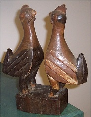 "Yoruba carved and painted wood tribal statue of a ""cock fight"""
