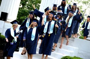 Graduating seniors passing through the columns at westminster college