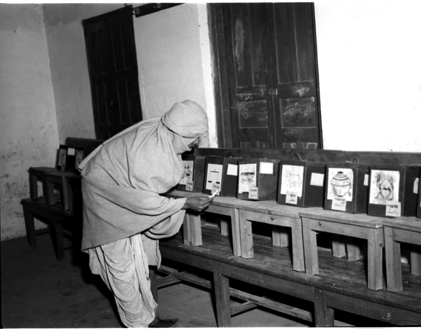 A voter casts his ballot during India's first general elections. Photo credit: Wikimedia Commons [Public Domain].