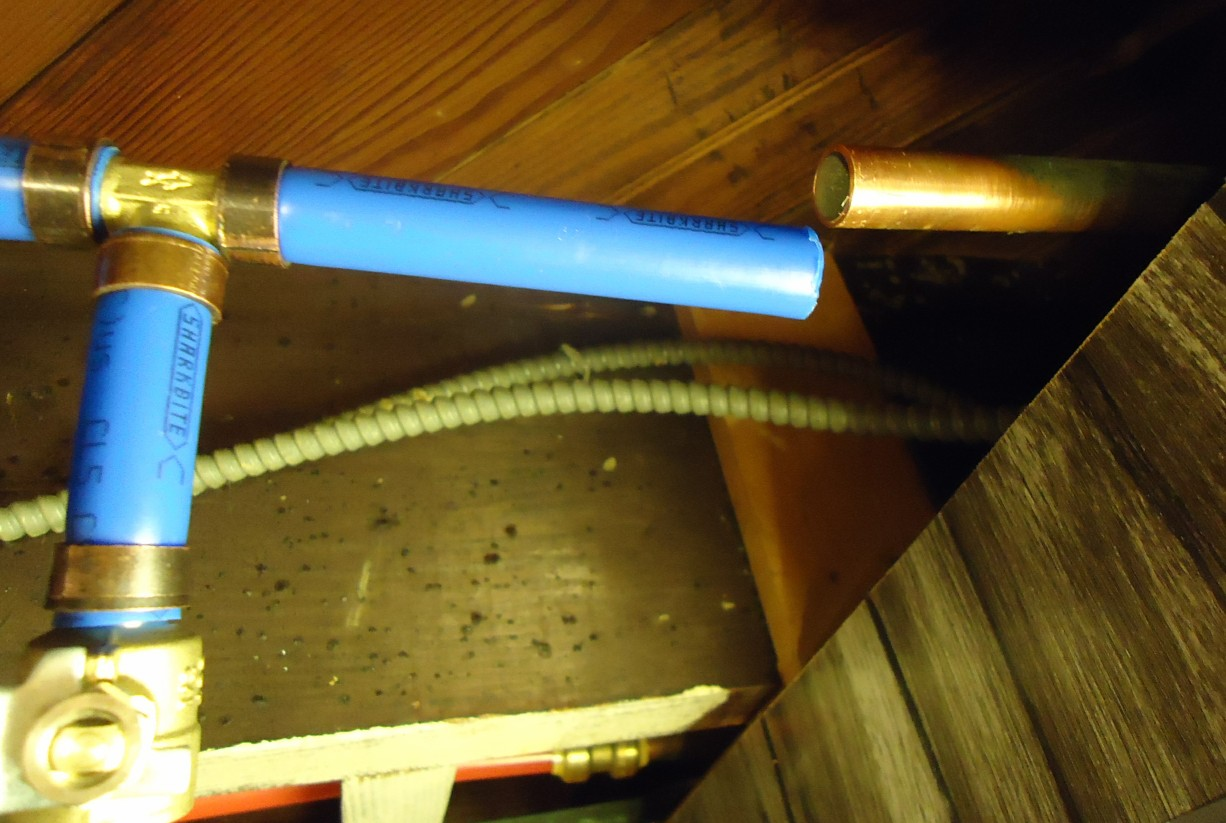 File:PEX pipes and valves in basement ceiling for exterior