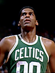 "A man, wearing a green jersey with a word ""CELTICS"" and the number ""00"" written in the front, is looking up."
