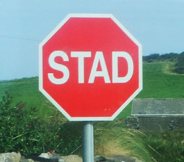 English: Irish language stop sign with text &q...