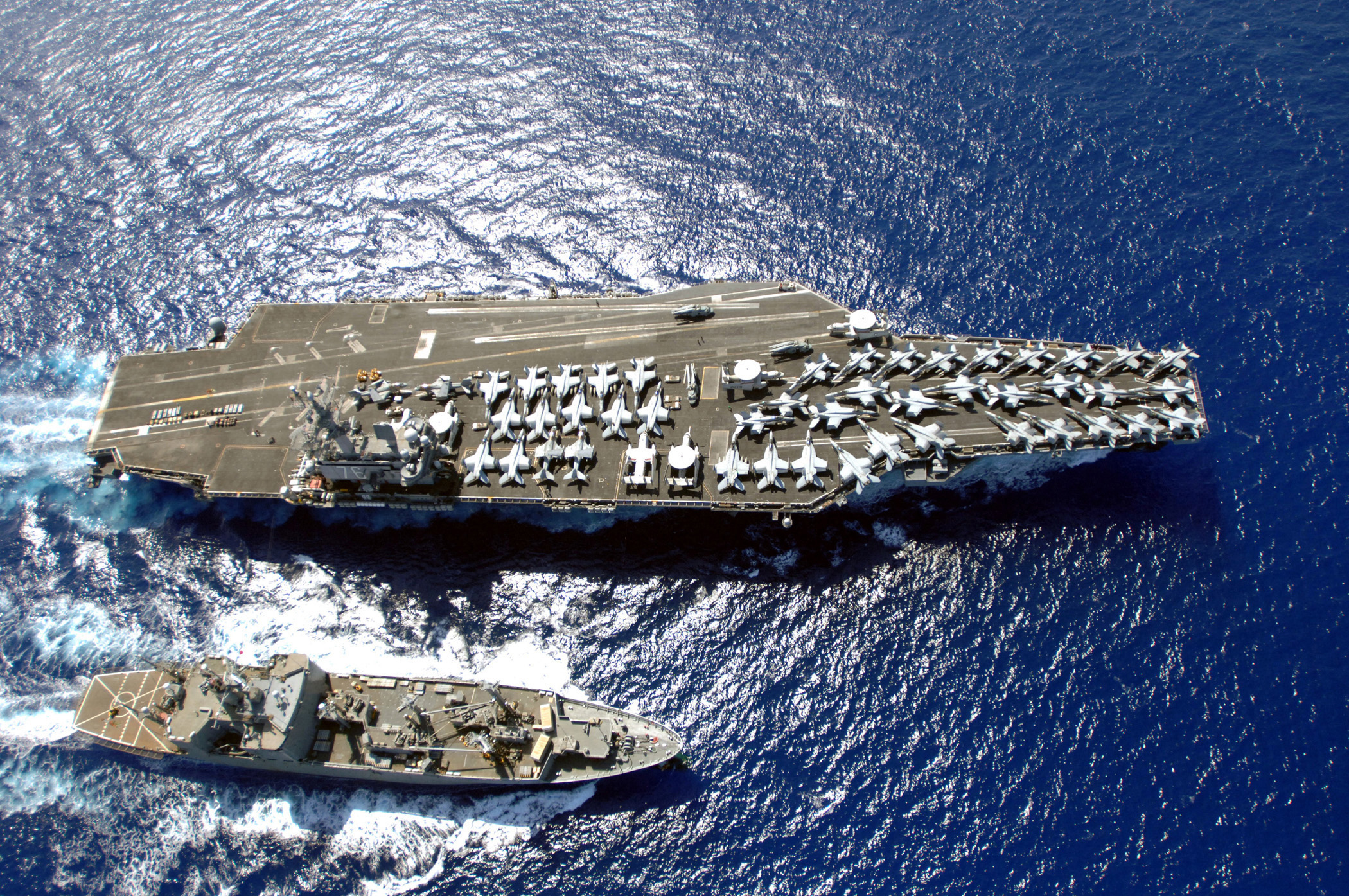 The_Nimitz-class_aircraft_carrier_USS_Ronald_Reagan_(CVN_76)_works_with_the_Military_Sealift_Command_ammunition_ship_USNS_Flint_(T-AE_32)_as_the_aircraft_carrier_unloads_all_of_its_weapons_signaling_the_end_of_070406-N-HX866-008.jpg