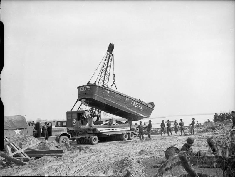 Landing craft unloaded by a crane on the banks of the Rhine