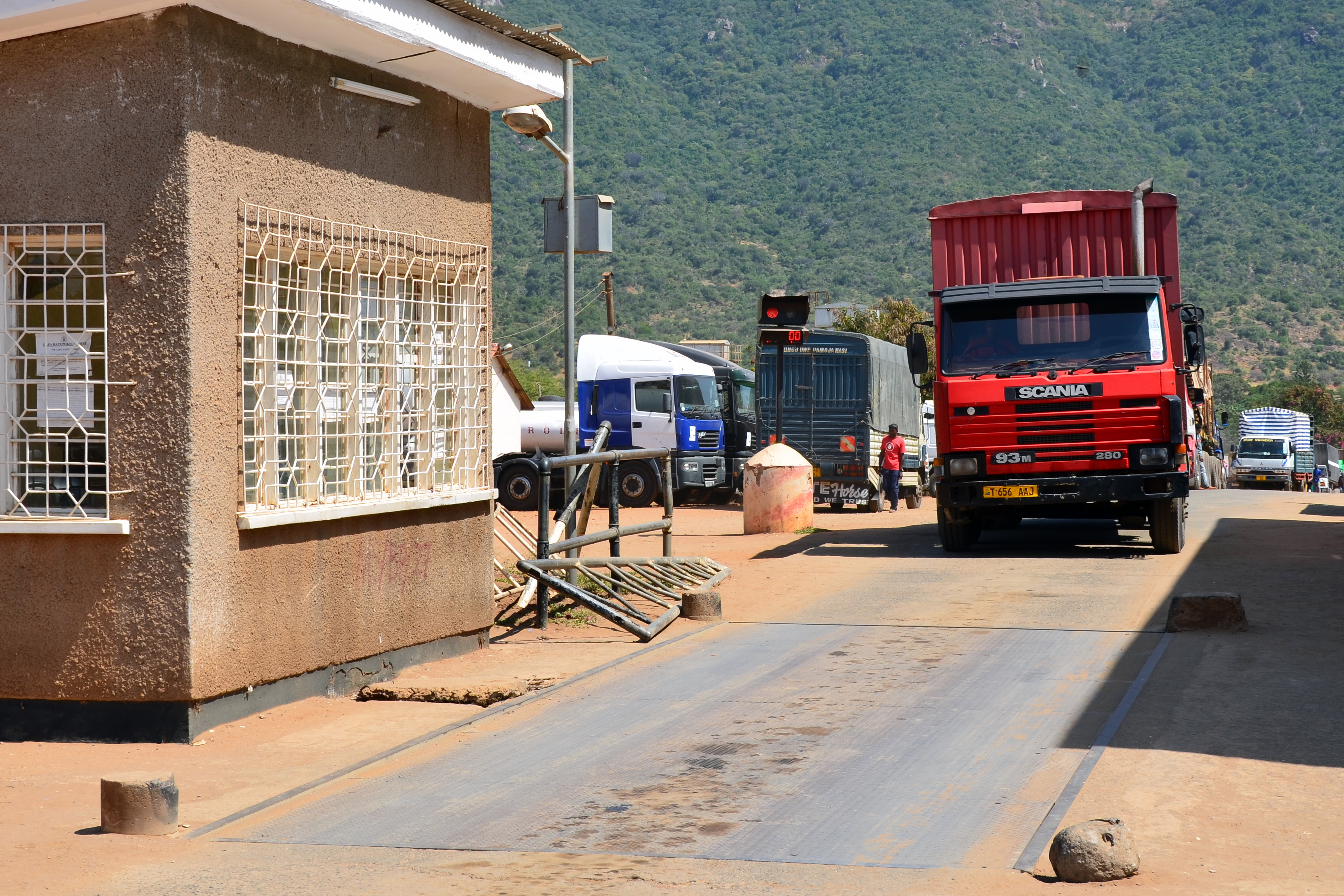 A truck in Tanzania drives onto a truck scale