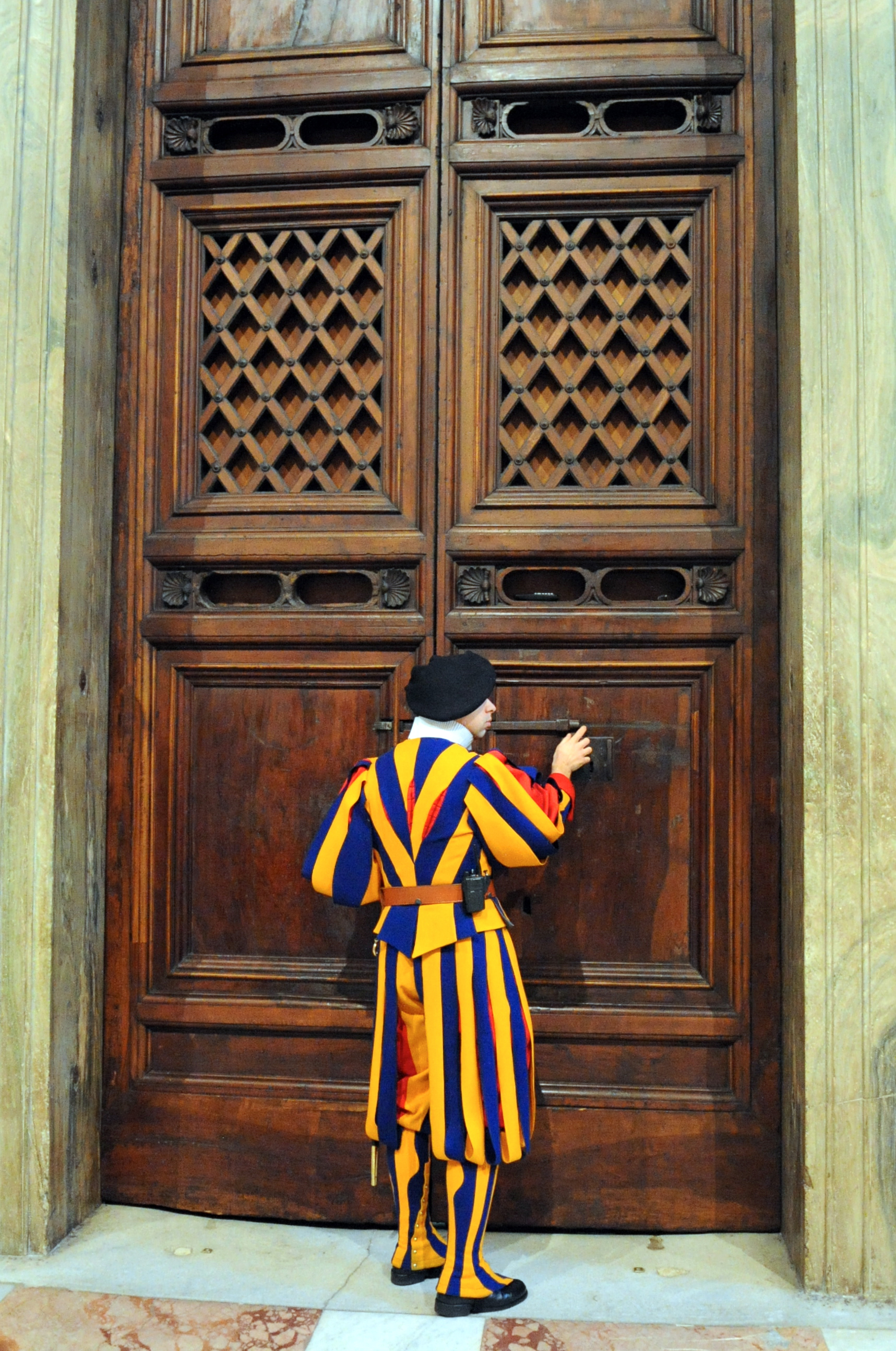 A Swiss Guard Unlocks the Door Outside of the Sistine Chapel for Secretary Kerry (11948661293).jpg