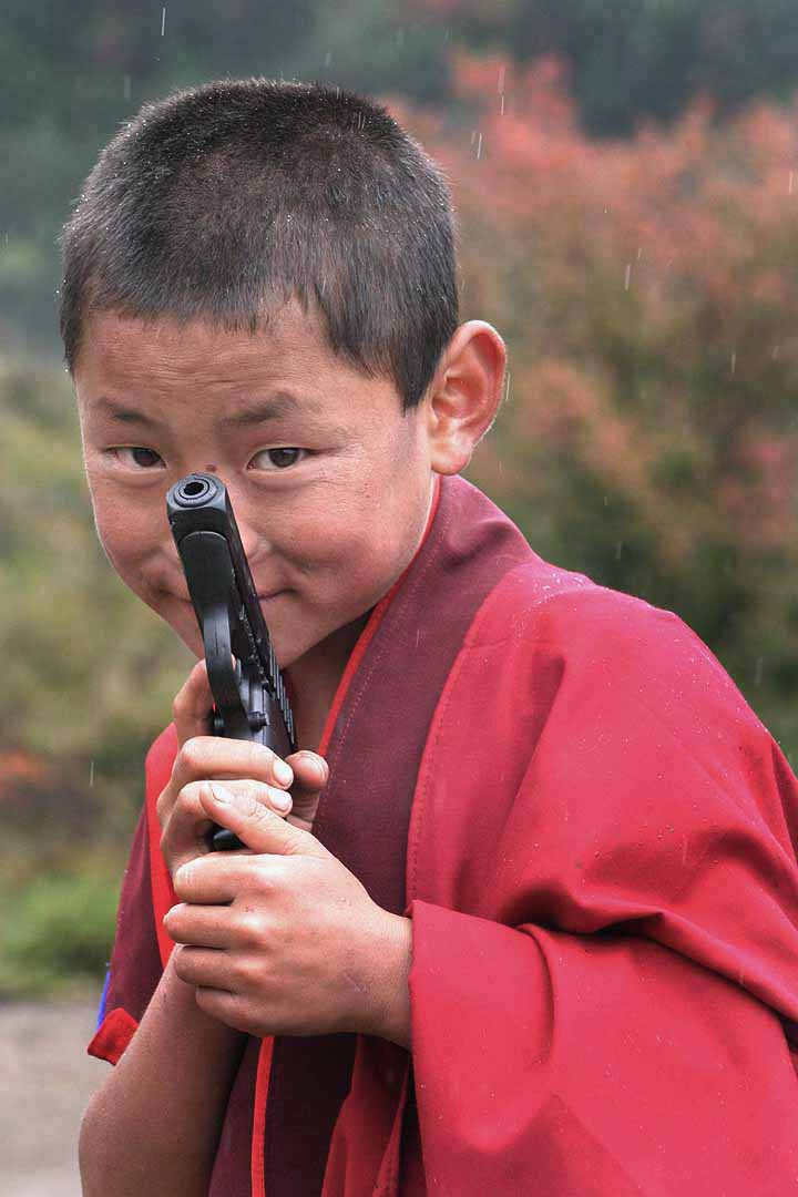 Image result for buddhist monk with gun