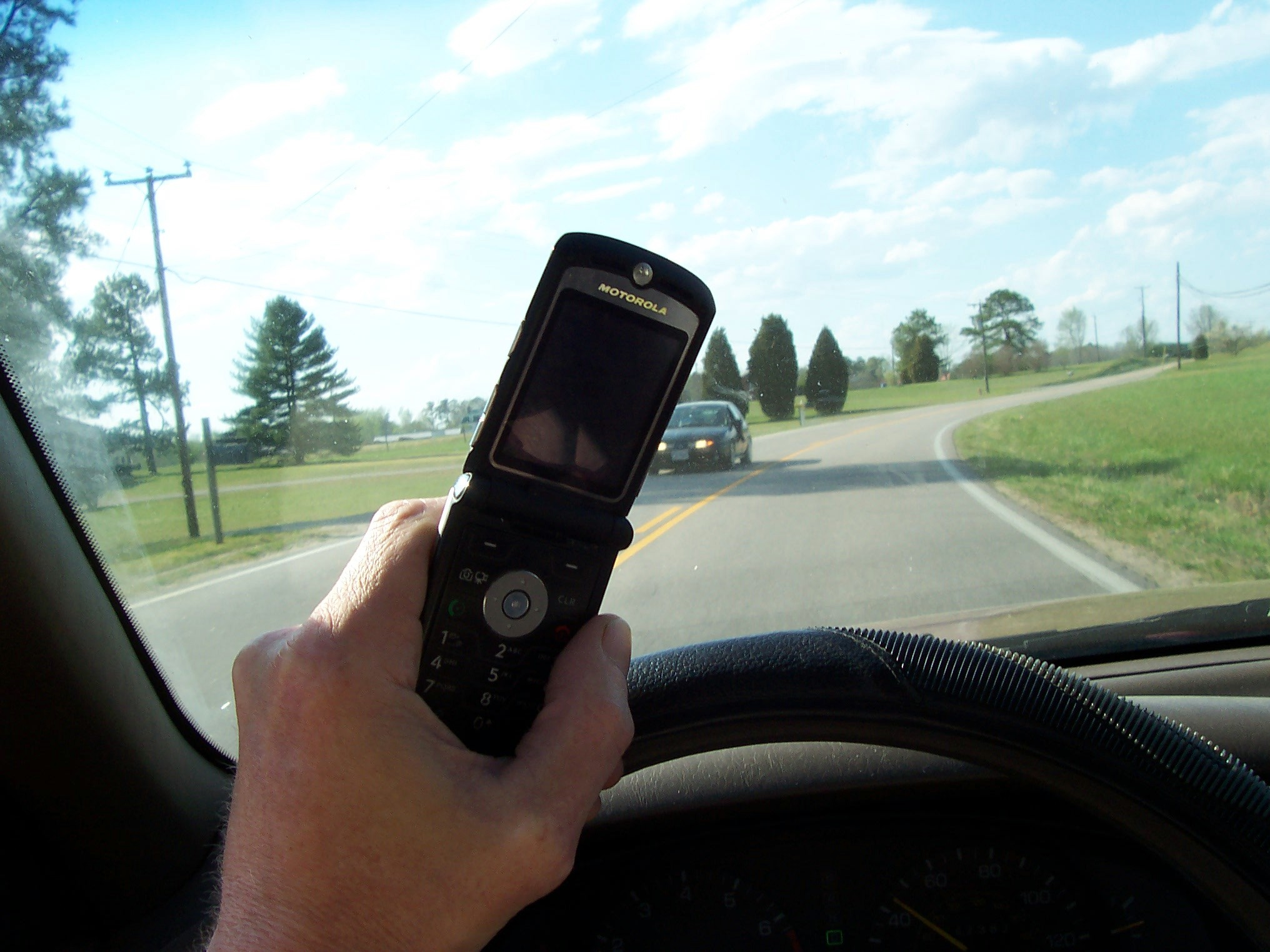 File:Cell phone use while driving.jpg