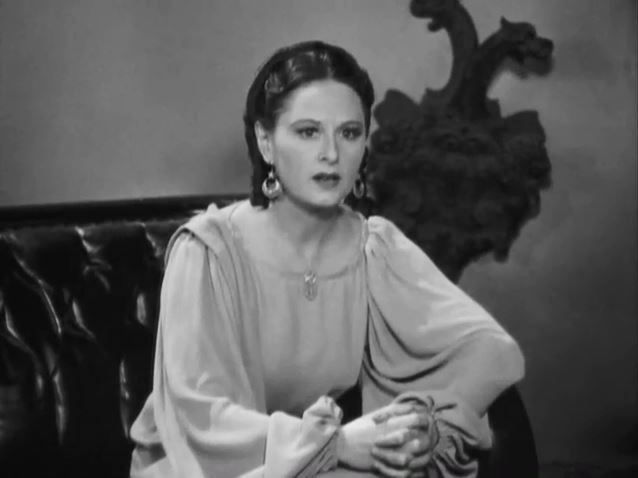 Gloria Roy from the American film Charlie Chan's Secret (1936) where she portrayed the psychic medium Carlotta.