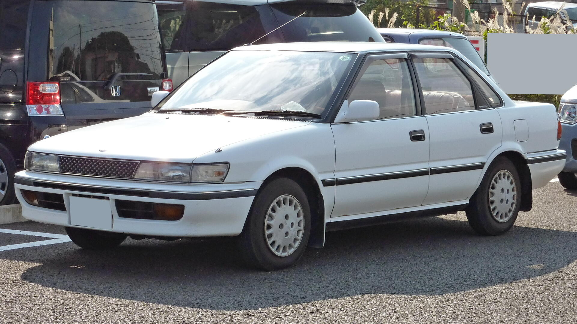 An example of a used 1990 Toyota Sprinter sedan from online used Japanese car exporter BE FORWARD.