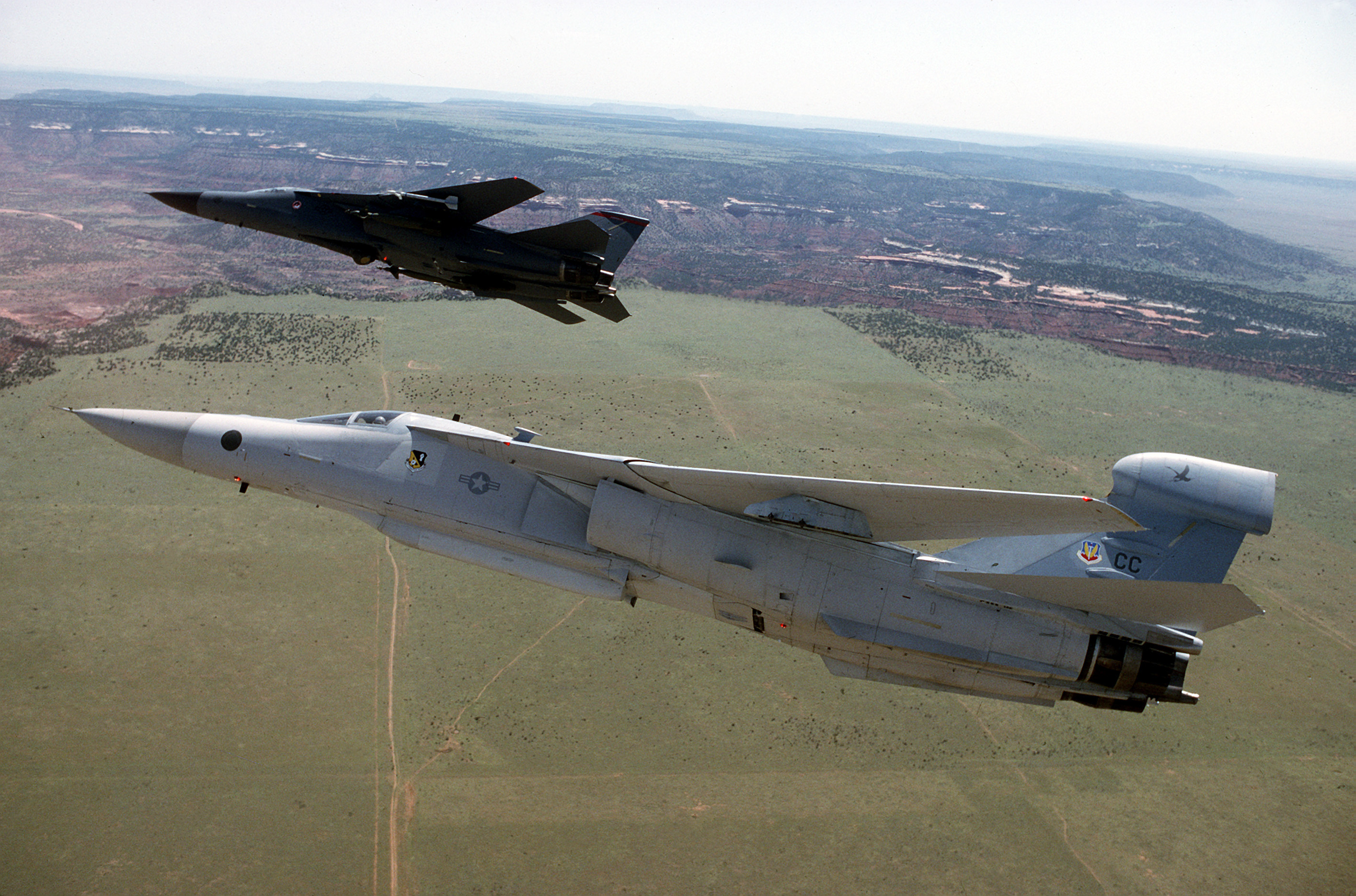 File:EF-111A and F-111F in flight.jpg - Wikimedia Commons