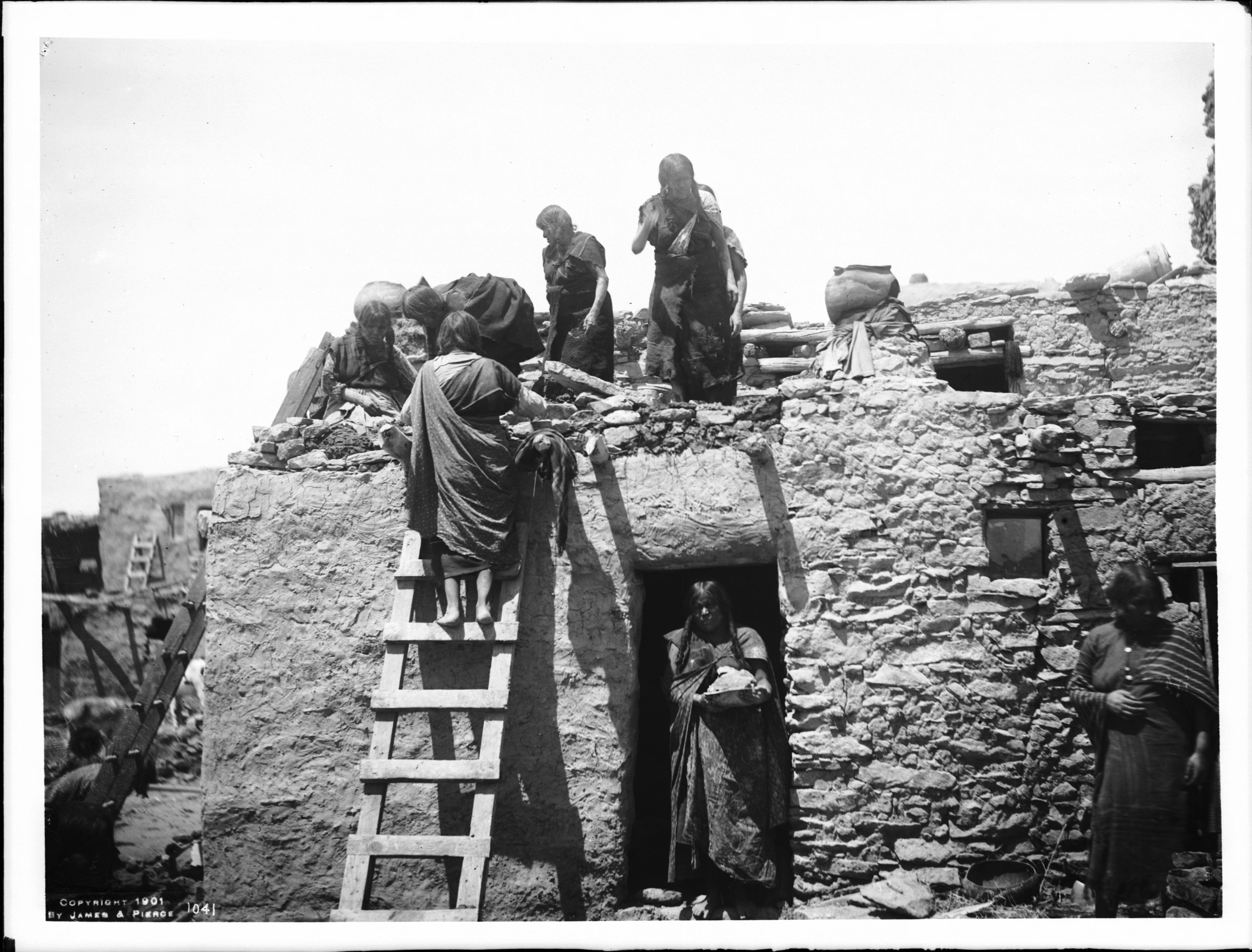 File Group Of Hopi Indian Women Building A House In The