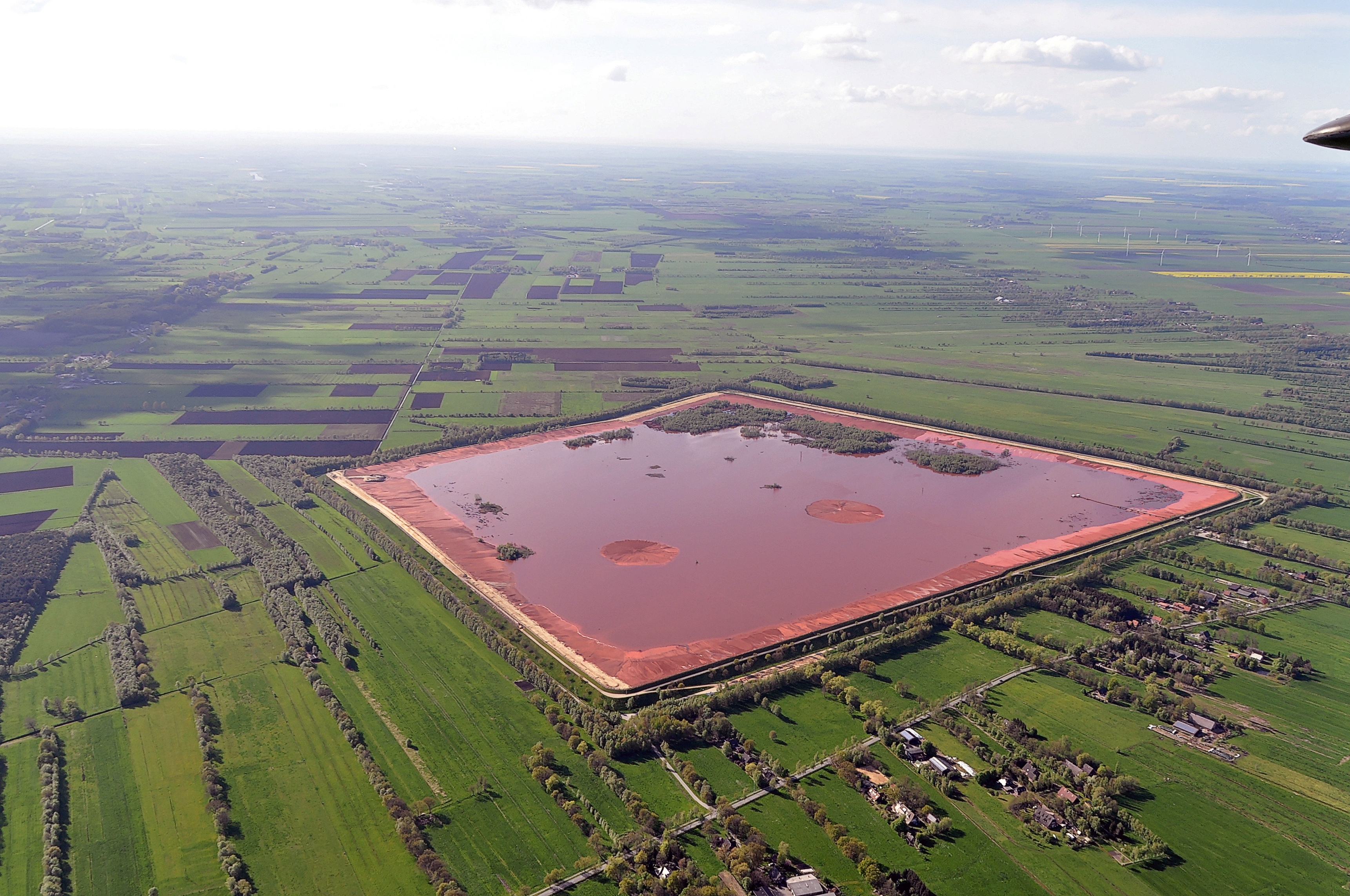 Red mud storage in Germany.  Image from Ra Boe via Wikipedia