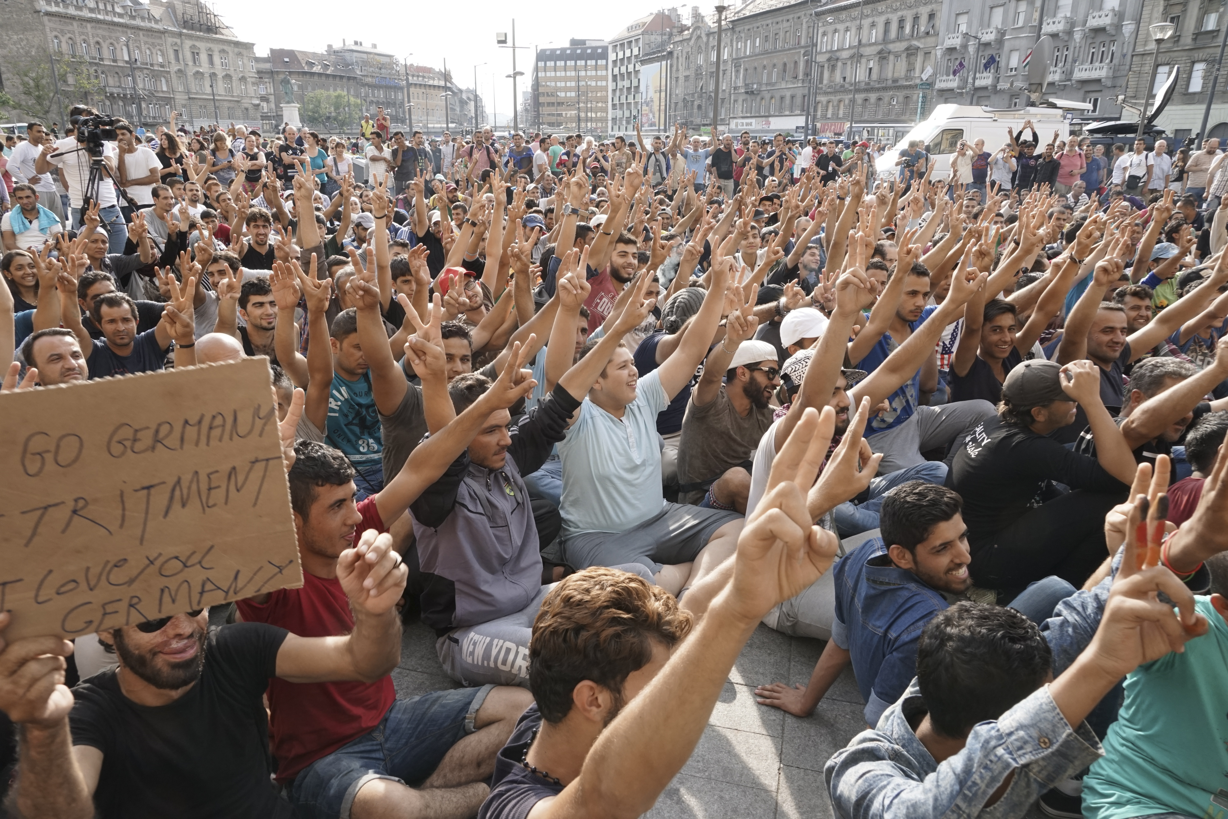 """A group of migrants- some of them Syrian, many from other places in the Middle East and Africa, congregated in Germany.  Sweden Democrats and the """"Race Against Time"""" Syrian refugees strike in front of Budapest Keleti railway station"""
