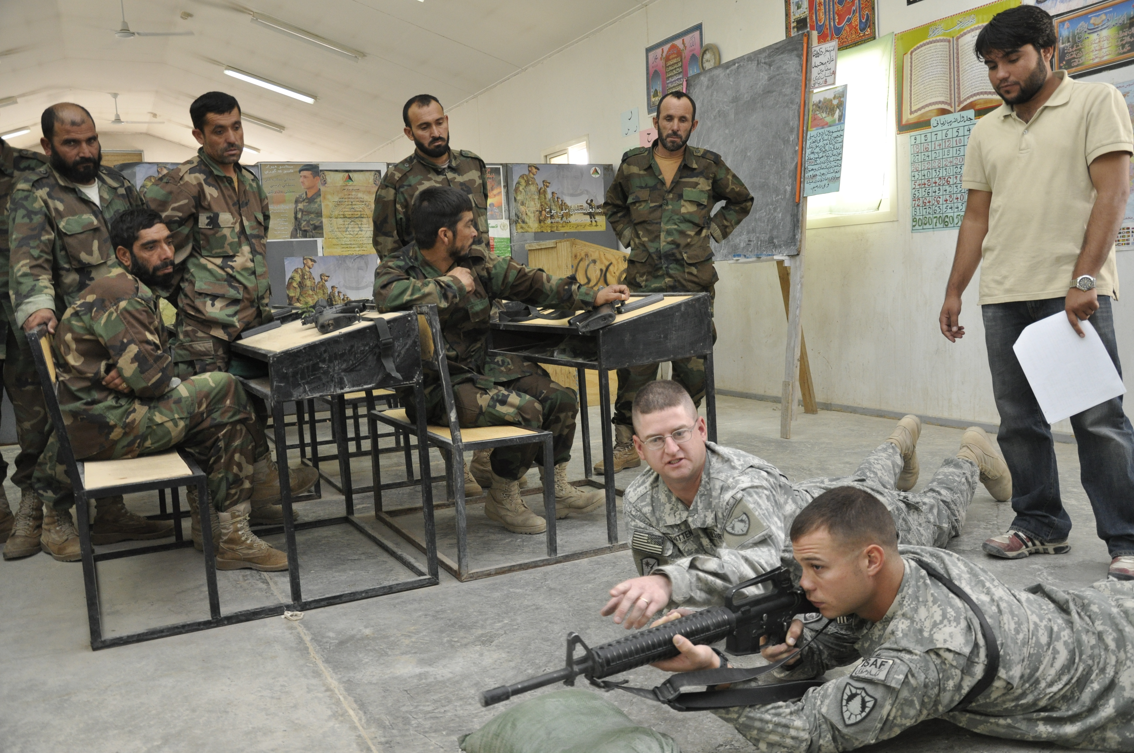 ... headquarters and headquarters company commander, explains while Staff