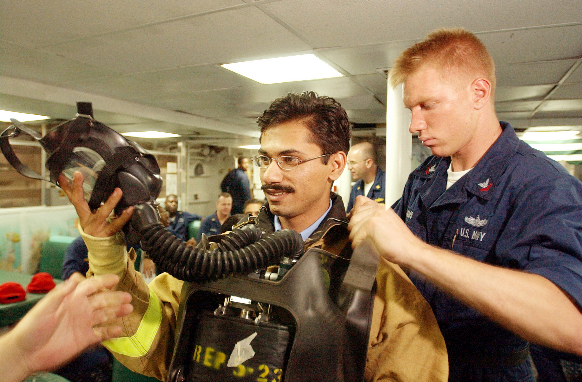 File:US Navy 020924-N-4309A-030 Damage Controlman assists with the ...