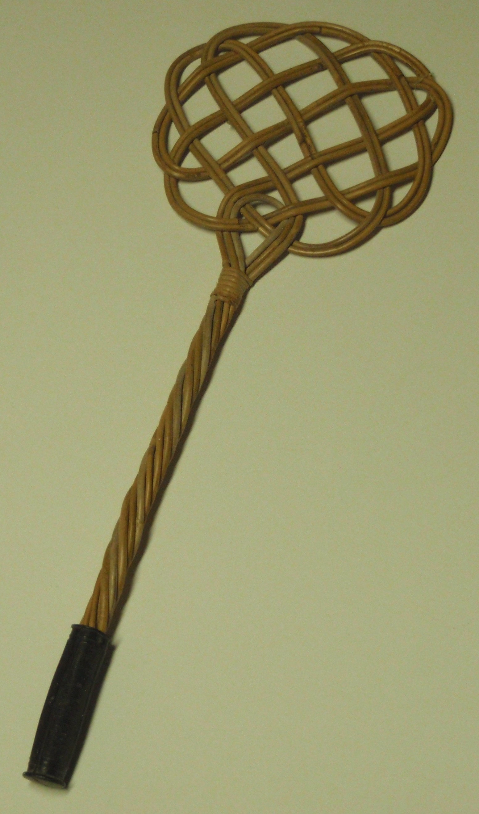 Old fashioned carpet beater