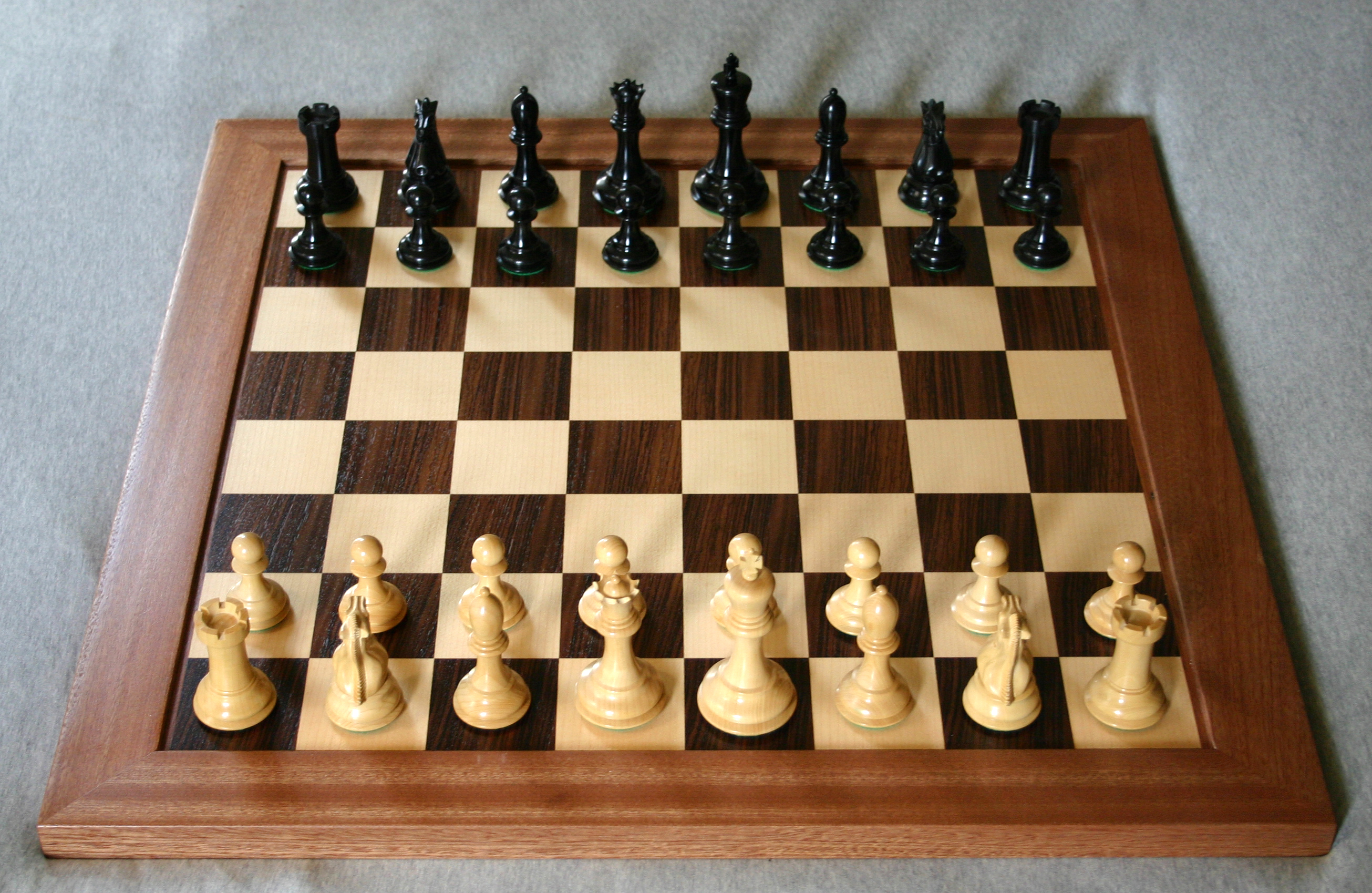 A Wooden Chessboard With Staunton Pieces