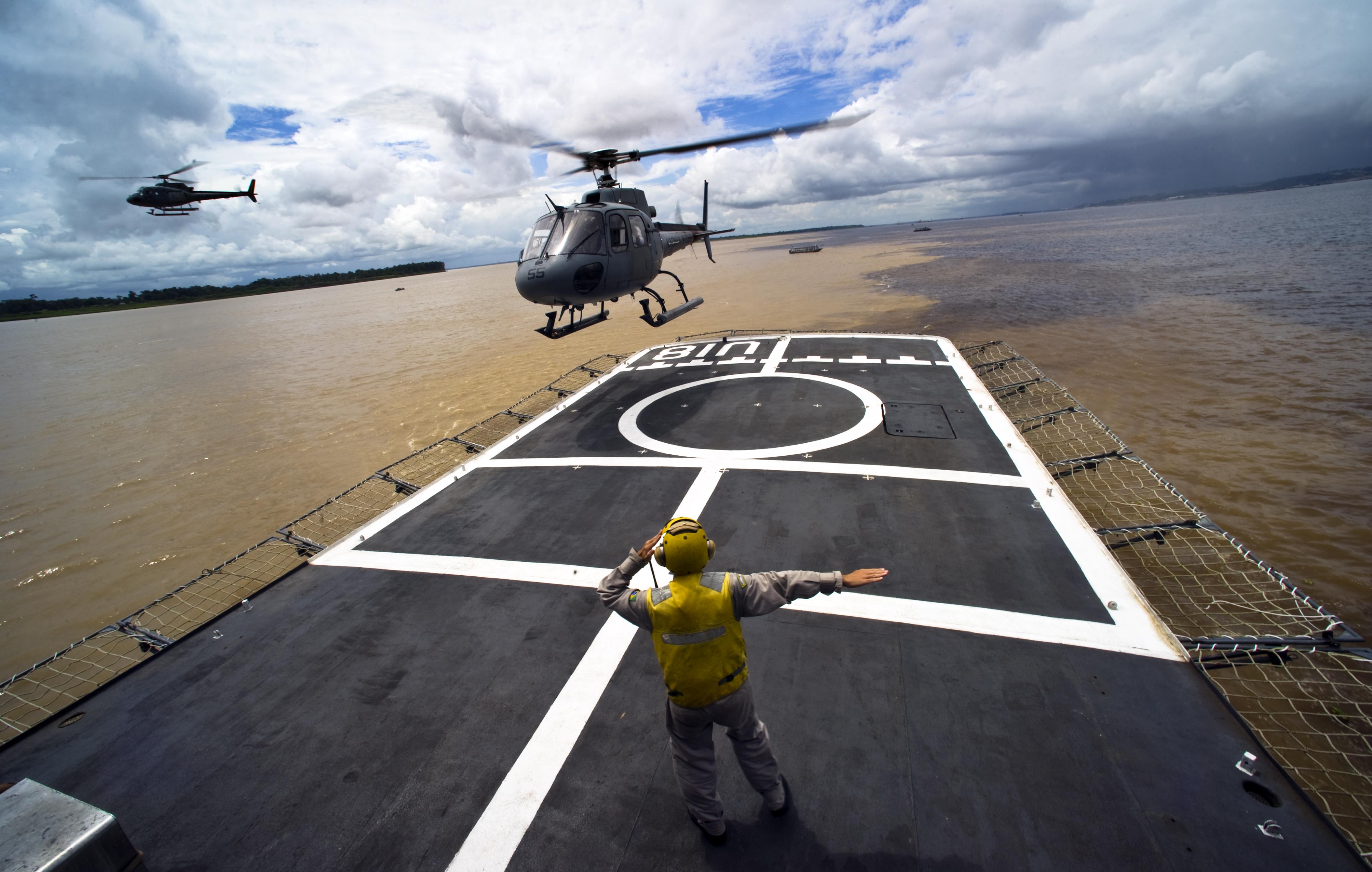 Flickr - Official U.S. Navy Imagery - Eurocopter transports Navy secretary onto Brazilian navy hospital ship.