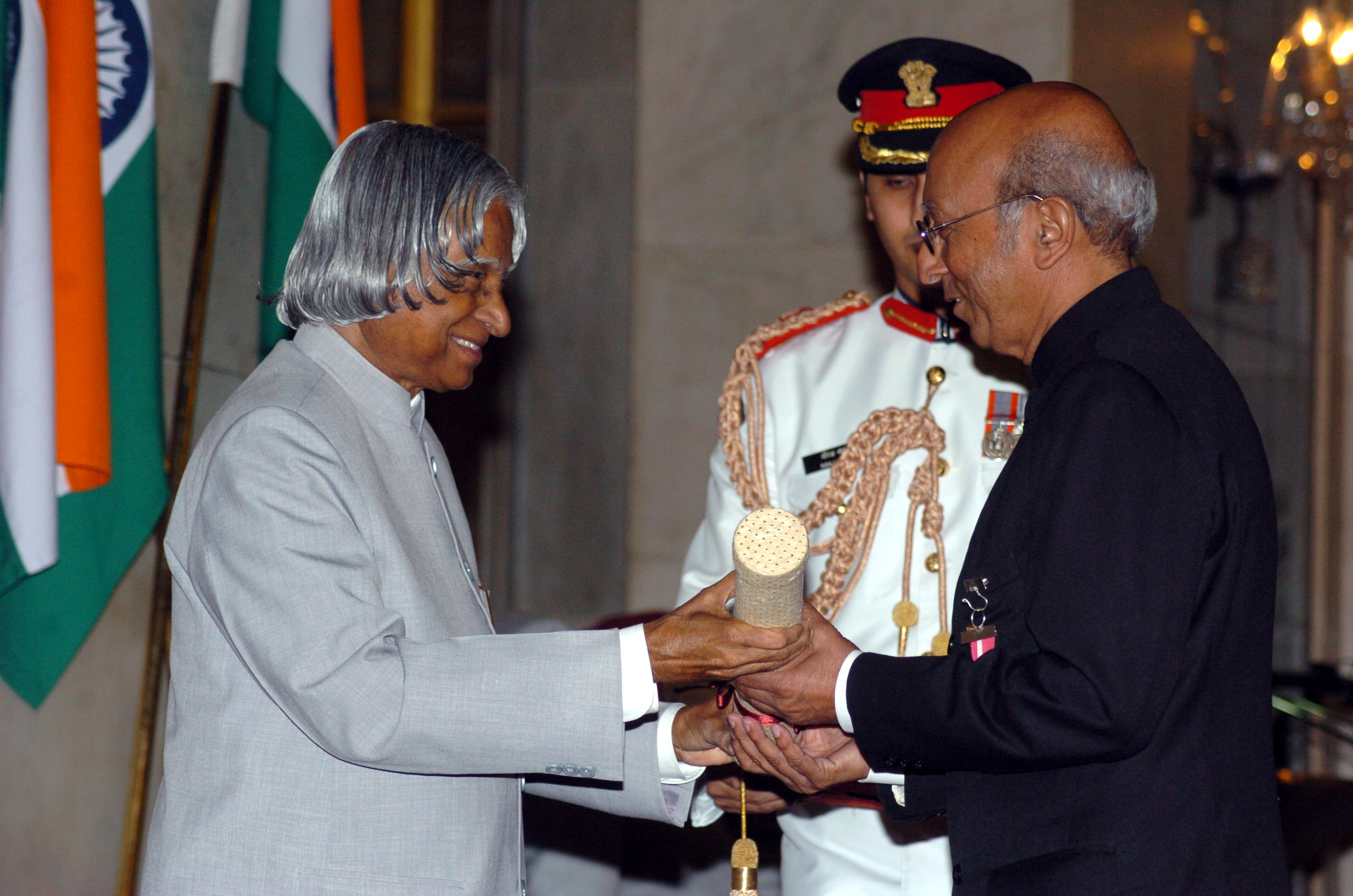 The President, Dr. A.P.J. Abdul Kalam presenting Padma Bhushan to Tarun Das (right), at investiture ceremony in New Delhi on 29 March 2006.