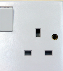 BS 1363 type electrical socket-outlet. The closed shutters block entry of foreign objects