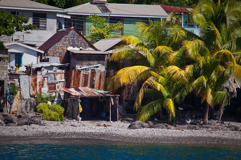 A shanty town near the sea, mixed with more standard homes.