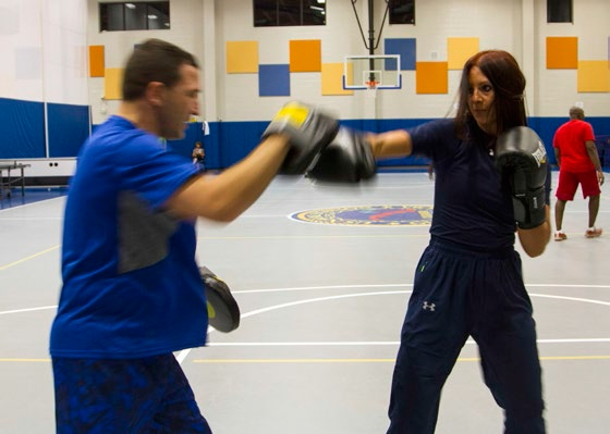 Ginger Hammack practices her punching technique on the focus mitts.jpg