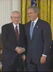 President George W. Bush shakes Hinckley's hand before presenting him with the Presidential Medal of Freedom, June 23, 2004.