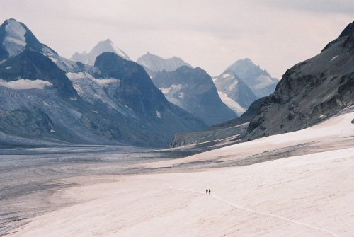 Part of the Haute Route between France and Switzerland; two alpinists can be seen following the trail in the snow.